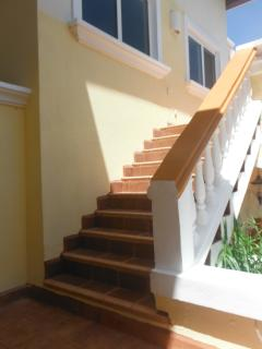 Access to the apartment is up a set of stairs