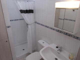 Shower room opposite twin bedroom, sink and toilet, washing machine enclosed in cupboard.NO BATH.