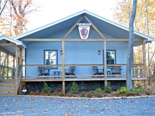 1000+ sq. ft. Cottage with covered decks  Artist designed insignia, not a real rangers cottage.