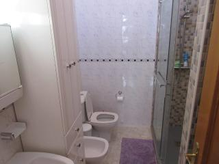 En suite with extra large shower  enclosure.   NO BATH