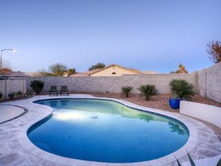 Spa like home, walk to U.O.P Stadium, with a private heated pool & putting green