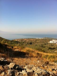 View towards Samos Island (Greece) from hillside paths accessible from behind penthouse apartment.
