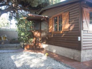 Estupenda parcela con casa de madera y piscina