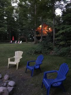 Summer nights: cabin seen from fire ring.