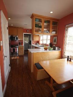 Sunny cooks' kitchen with built-in breakfast nook for 6