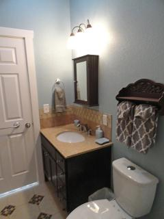 Full bath with tub and shower features handcrafted walnut vanity
