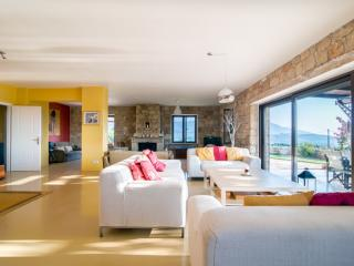 open plan living and dining area with west facing sea and mountain views