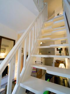 Stairs leading up to the spacious double bedroom
