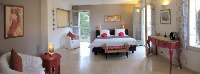 The largest bedroom (bed 180) with en suite bathroom.  It looks towards the pool and gardens