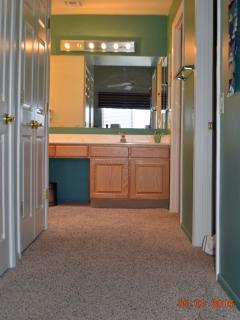 MBR Hallway Accessing A Walkin Closet, Linen Closet & Washer/Dryer Closet.