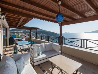 Full length balcony with jaccuzi at far end and dining table and two sofas at pool/Kalkan town end.