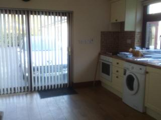 One bed apartment en suite with fully fitted kitchen ,living, dining room. secluded garden patio