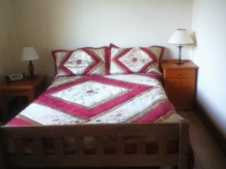 Spacious double bedroom, bright and overlooking garden pond