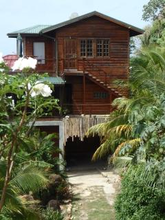 Side view stair access to upper separate and also private Coconut Suite.