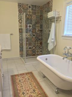 Opulent bathroom - Italian tile surround this beautiful glass shower with rainhead and handheld.