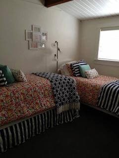 Downstairs bedroom with 2 twin beds and one pull out trundle