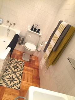 One of 2 bathrooms - bath, shower, basin, toilet