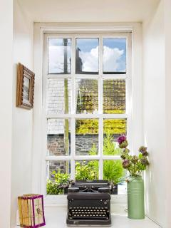 Enjoy the vistas out the original sashed windows