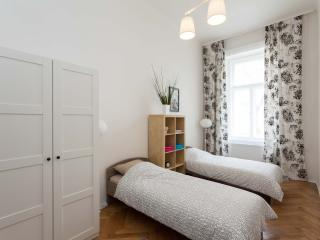 The large Bedroom with two single beds