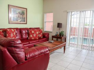 Relax in the living room and face the inviting, fully enclosed lanai.