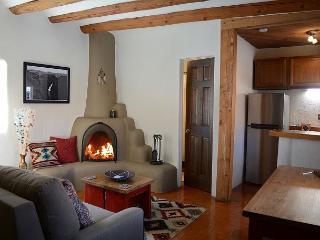 Authentic wood burning kiva fireplace adds traditional romantic southwest ambiance