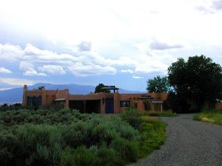 360 mountain views, adobe walled private yard & patios  5 Fireplaces, Taos