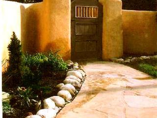 Historic Taos adobe walk to town kiva fireplace DSL internet fenced yard