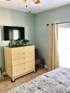 Large Chest-of-Drawers and 46 inch HD TV in Master bedroom.