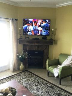 50 Inch, 4K,  TV over Rustic, barn wood, Fireplace