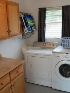 laundry room with beach chairs