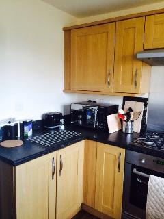 Modern kitchen with all white goods including Dishwasher and tall fridge/freezer.