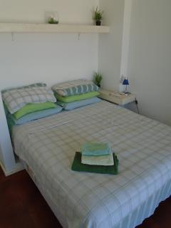 The master bedroom has a queen sized bed with a good quality mattress