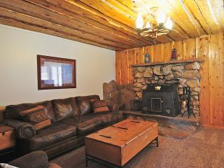 Cabin atmosphere with wood stove. Comfy couch and flat screen tv.