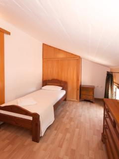 2nd storey 1st bedroom sleeps 3 single bed