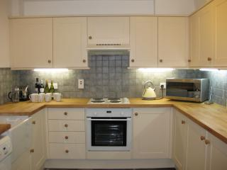 well fitted kitchen with Belfast sink, washer dryer, microwave, toaster