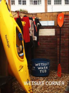 Wetsuit & outdoor sports gear washing & drying area.