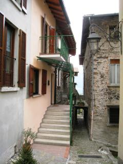 Sant Agata entry-terrace with master bedroom balcony above offers lake glimpses