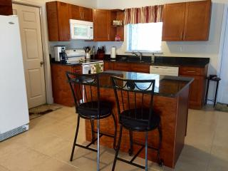 Fully equipped kitchen open to dining and living rooms