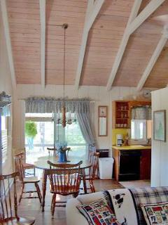 Open living with cathedral ceiling in family room.