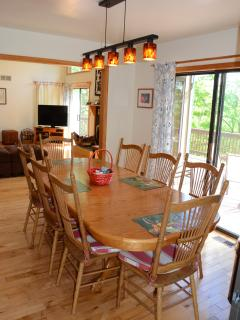 Dining Room with large table. Adjacent to the Living Room and Kitchen.