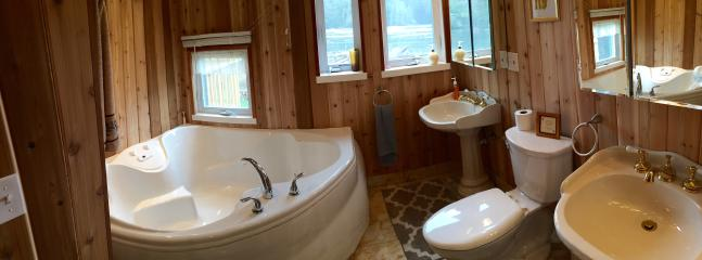 Full bath downstairs with jacuzzi tub, radiant marble tiles, cedar walls, overlooing the lake.