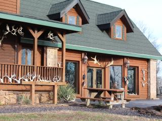 front of lodge with antler decor