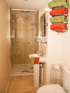Our shower room has underfloor heating, heated towel rail, fluffy towels, complimentary toiletries.