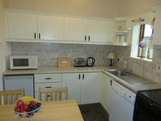 Fully equipped kitchen: dishwasher, m/wave, fridge and cooker.  Washing machine and tumble dryer.