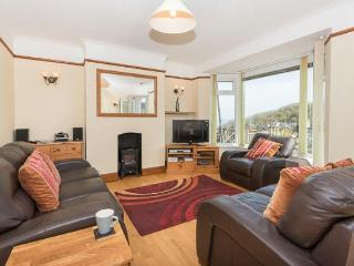 This spacious lounge enjoys splendid views and comfortable leather sofas