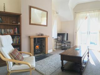 The Living Room has been recently updated with a log burning stove and 2 comfy sofas