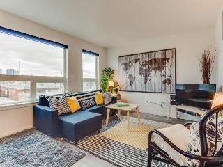 Pet-friendly Capitol Hill condo w/ city views, a shared roof deck & gym!, Seattle