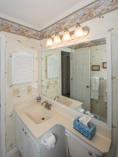 Main Bath with large mirror and countertop.