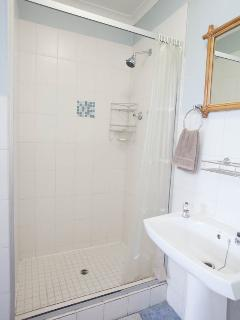 EN SUITE IN MAIN BEDROOM WITH SHOWER TOILET AN HAND BASIN.