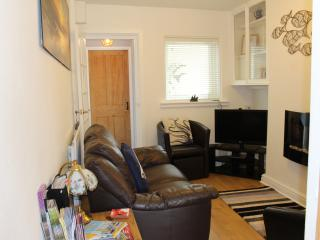 Cosy lounge with electric wall hung living flame fire.  32' L.G. T.V. with Freeview.